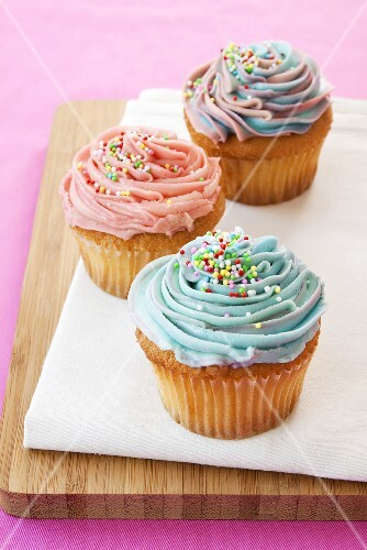 Cupcakes with coloured icing and hundreds and thousands