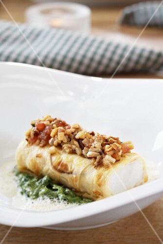 Whitefish fillet wrapped in a porcini mushroom crepe