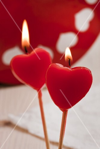 Two red heart-shaped candles