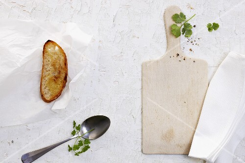 Toasted bread, a spoon and a chopping board