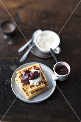 Buttermilk waffles with plum compote and whipped cream