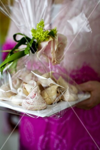 A woman holding homemade meringue biscuits as a gift