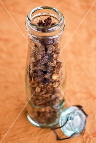 Roasted peanuts in a storage jar