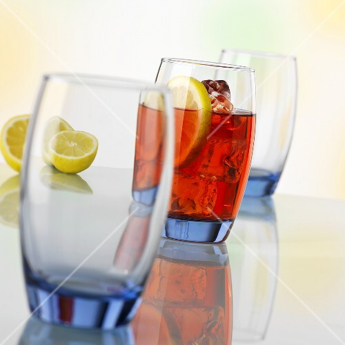 A red drink in a purple glass