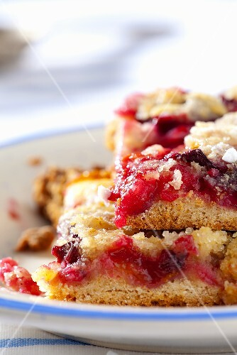Slices of plum and apple cake