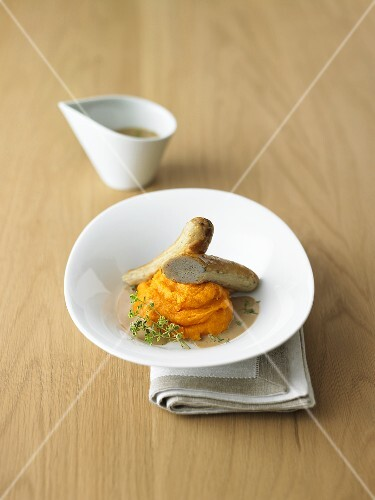 Rabbit sausages with thyme-vanilla sauce and pureed carrots