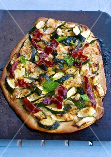 Pizza with courgette, Serano ham and mint