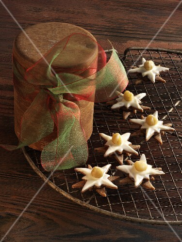 Nougat stars with hazel nuts on a cooling rack