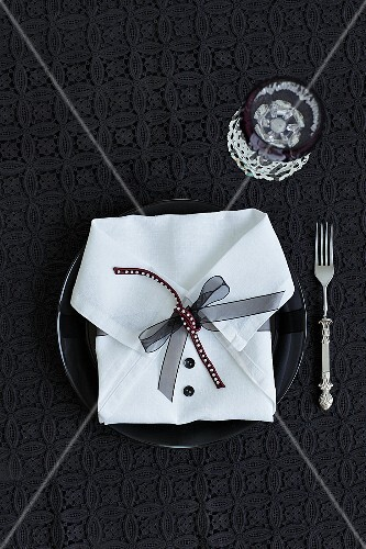 A napkin folded to look like a shirt