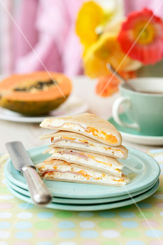 Pancakes filled with ricotta, ham and egg