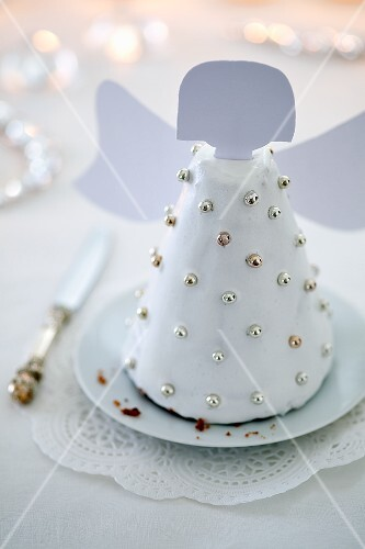 An angel cake with silver balls