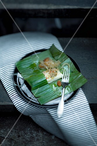 Halibut wrapped in banana leaves