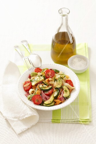 Colorful home made ribbon noodles with zucchini tomato sauce
