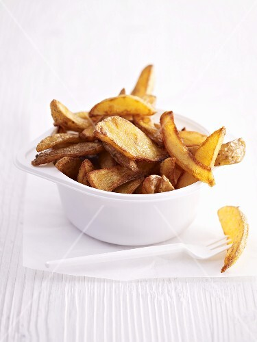A plastic bowl of country potato wedges