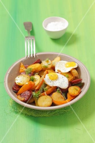 Roast potatoes with chorizo, pepper and fried quail's egg