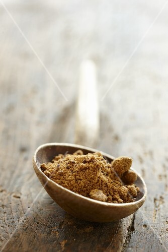 Natural brown sugar on a wooden spoon