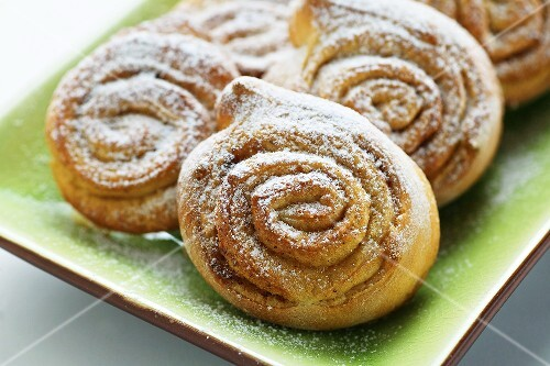 Cinnamon buns on a light green plate