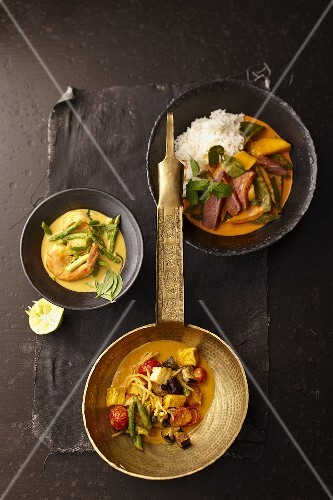 Green prawn curry, red duck curry and yellow vegetable curry (Thailand)