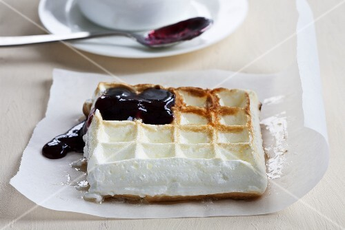 Meringue waffles with blueberry sauce