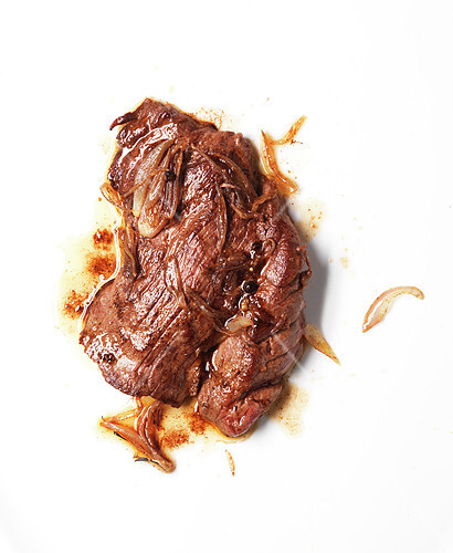 Grilled flank steak with onions and pepper