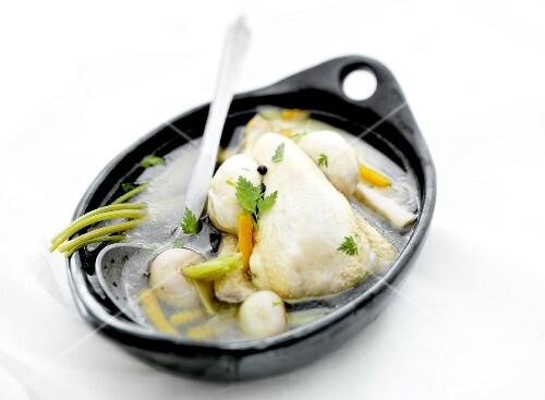 Chicken in a seasoned vegetable broth