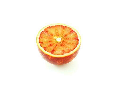 Half a blood orange on a white background