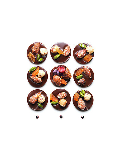 Dried fruit and chocolate Mendiants composition on a white background