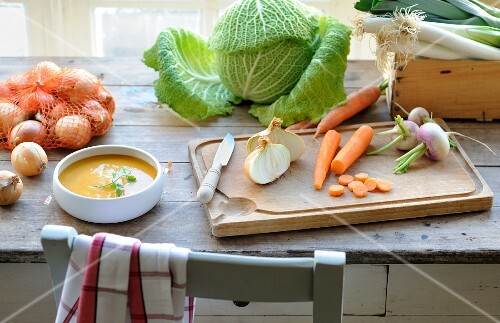 Preparing a homemade vegetable soup in the kitchen