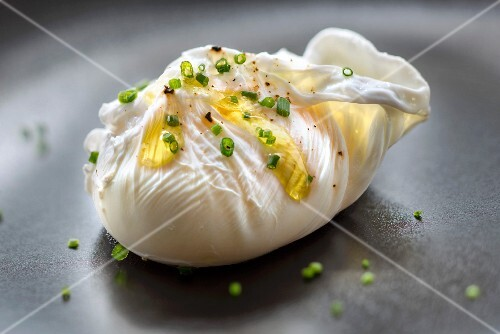 Poached egg with olive oil and chives