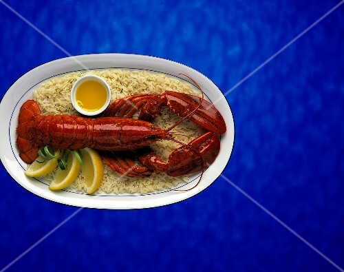 Whole Cooked Lobster served on a bed of rice