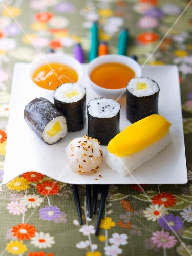 Assortment of exotic fruit sweet makis and sushis