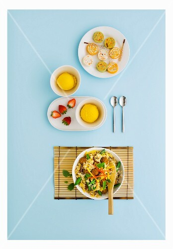Asian menu with sauteed rice and chicken balls