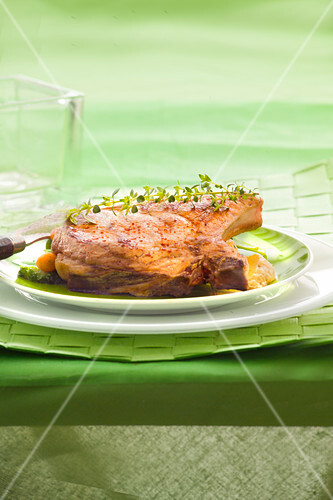 Veal chop grilled with Espelette pepper-flavored salt and fresh thyme, pan-fried vegetables