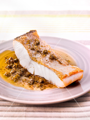 Pollock steak with capers and anchovies