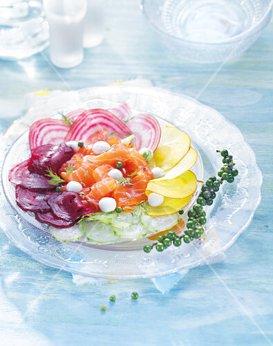 Rainbow dish with smoked salmon and vegetable carpaccio with mini mozzarella balls