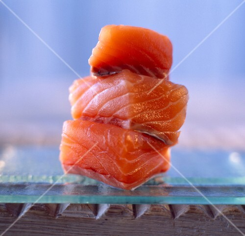 Cubed raw salmon