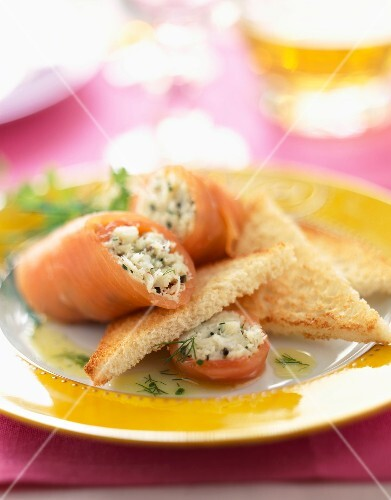 Smoked salmon rolls filled with crab