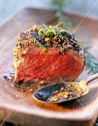 Beef steak coated in mustard