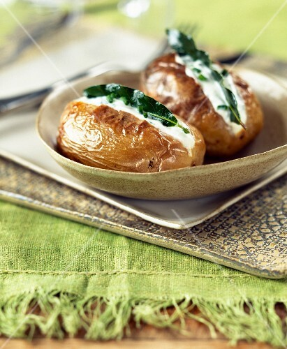 Baked potatoes with fromage frais and herbs
