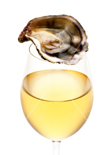 Oyster and glass of white wine
