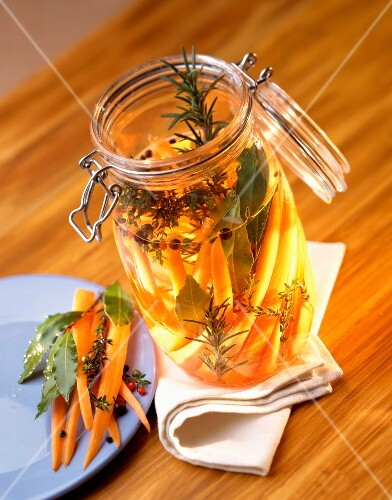 Jar of carrots marinated in herbs