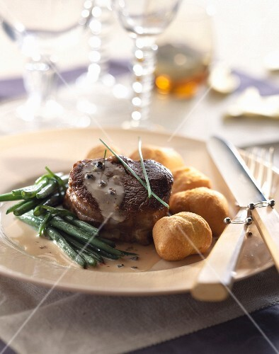 Tournedos with pepper sauce and dauphine potatoes