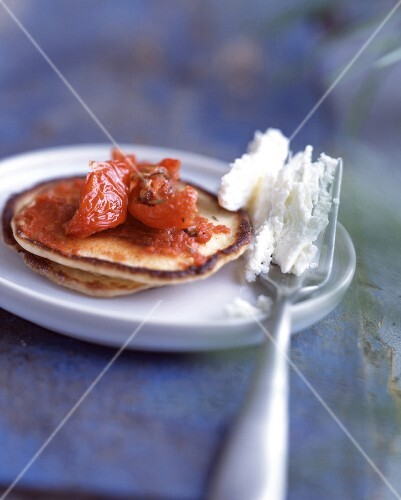 Blinis with stewed tomato caviar and Brousse cheese