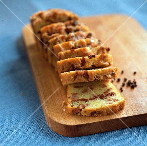 Savoury loaf cake with dried tomatoes and smoked ham
