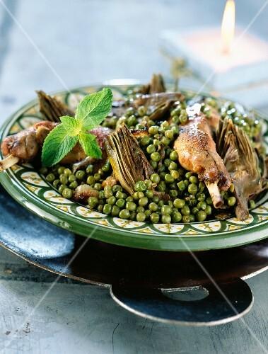 Pea, rabbit and artichoke tajine
