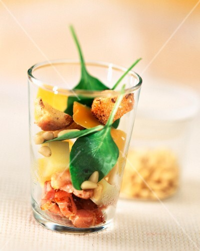Bacon, potato and cheese salad in glass