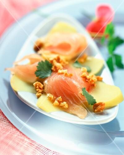 Sea bream carpaccio with peanut and coriander sauce