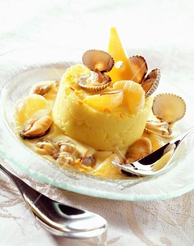Cockles with potato puree, saffron and tangerine