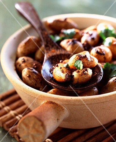 Cooking pot of spiced potatoes