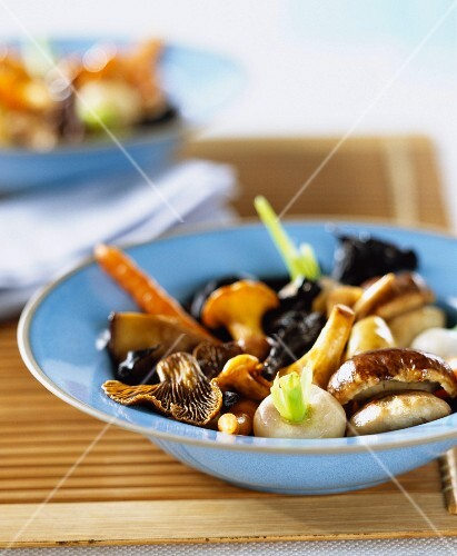 Fried vegetables and mushrooms in bowl